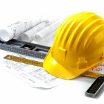 isolated hard hat with tools and blueprint on white